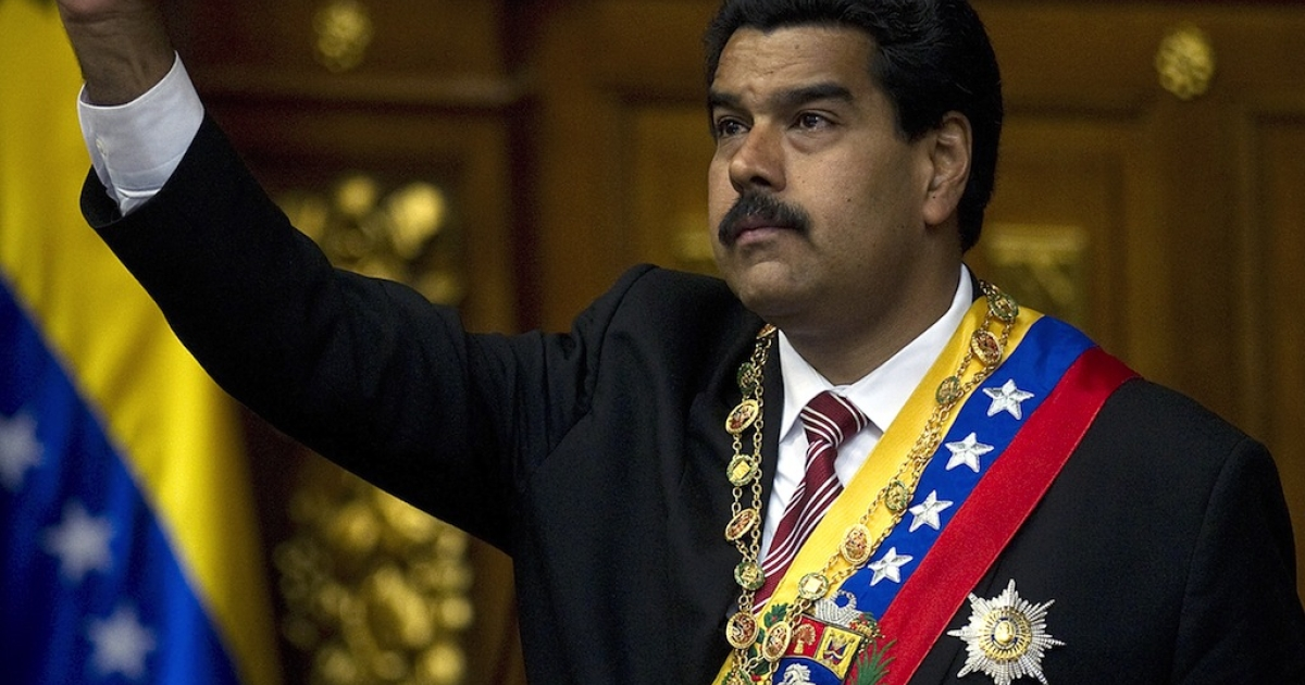 Venezuelan acting president Nicolas Maduro clenches his fist after he was sworn in as acting President, in Caracas, on March 8, 2013. Maduro took over as acting president in a ceremony rejected by the opposition after a tearful farewell to Hugo Chavez during a rousing state funeral for the firebrand leftist.</p>