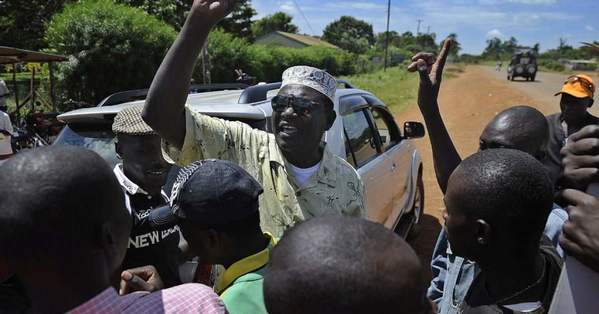 President Barack Obama's Kenyan half brother, Malik Obama (C) rallies supporters on January 16, 2013 near Nyang'oma in Kogelo, now renowned as the Obama's traditional home. Malik accused the Kenyan election commission of concealing official results of the Siaya governorship race after losing his race.</p>