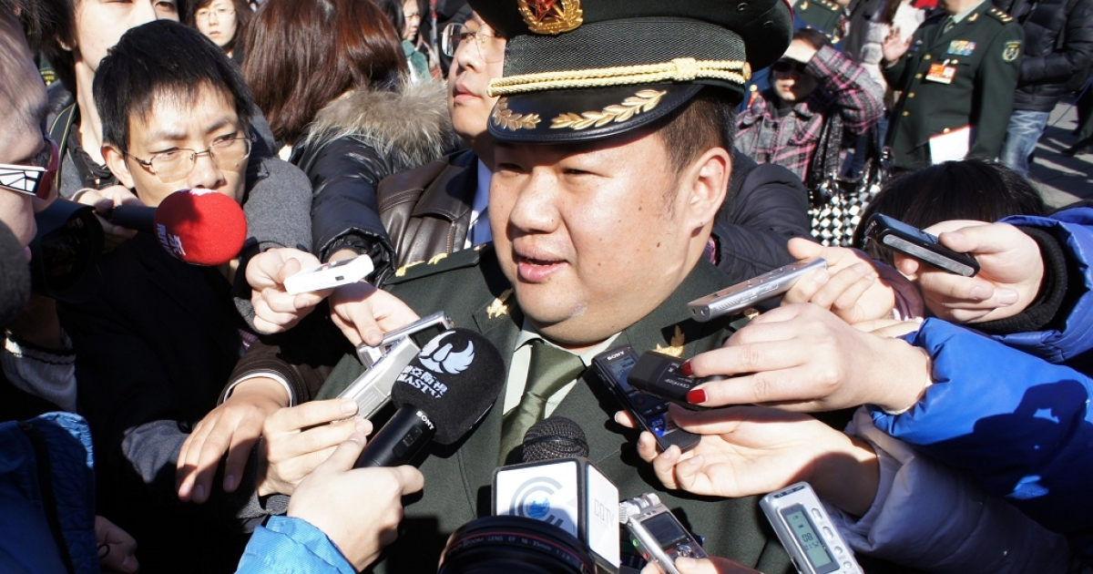 The delegate Mao Xinyu, grandson of Chairman Mao Zedong, is surrounded by reporters as he walks to the Great Hall of the People before the opening ceremony of the Chinese People's Political Consultative Conference on Mar. 3, 2011 in Beijing, China.</p>