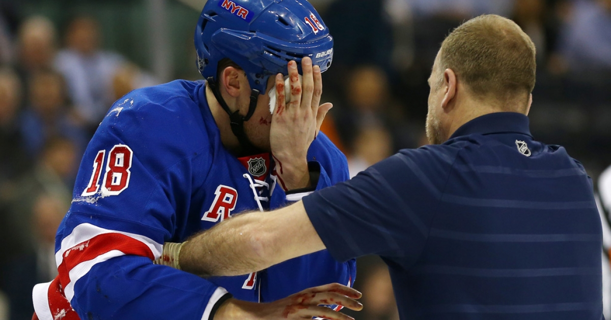 Marc Staal of the New York Rangers leaves the ice after he was hit in the face with a puck in the third period against the Philadelphia Flyers on March 5, 2013 at Madison Square Garden in New York City.The New York Rangers defeated the Philadelphia Flyers 4-2.</p>