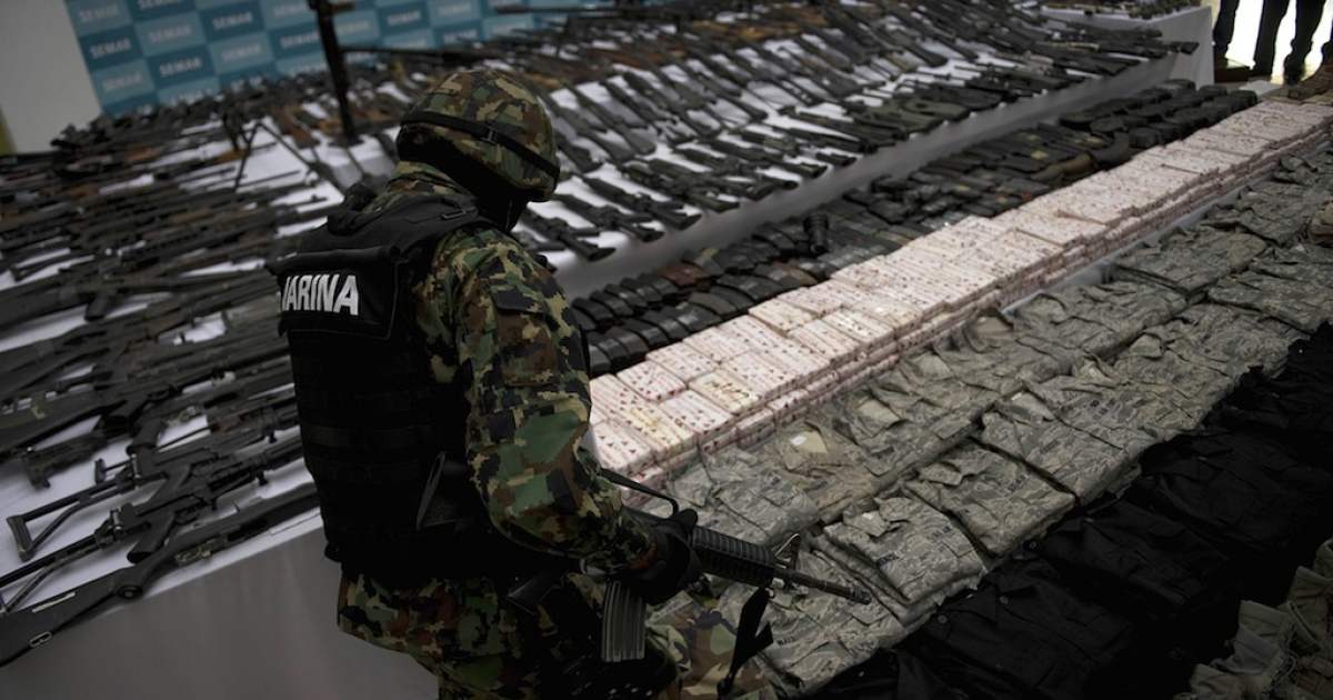 Firearms, cocaine and military uniforms seized from alleged members of the Zetas drug cartel are presented to the media on June 9, 2011.</p>