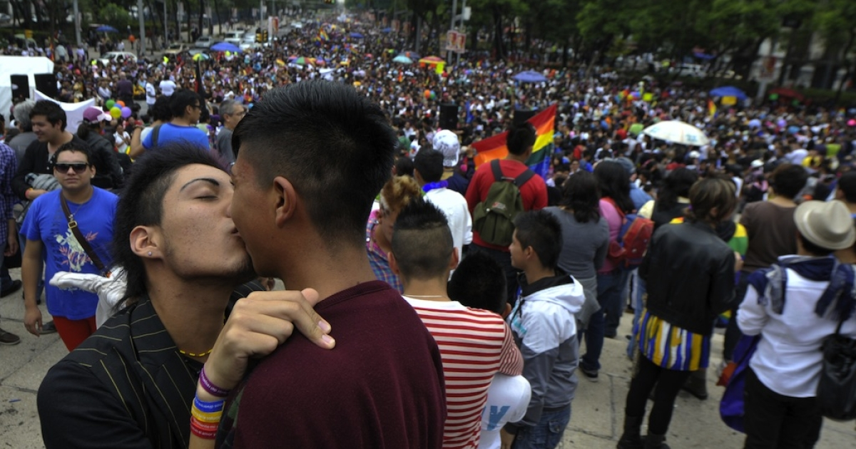 Two men kiss during the Gay Pride Parade in Mexico City on June 30, 2012.</p>