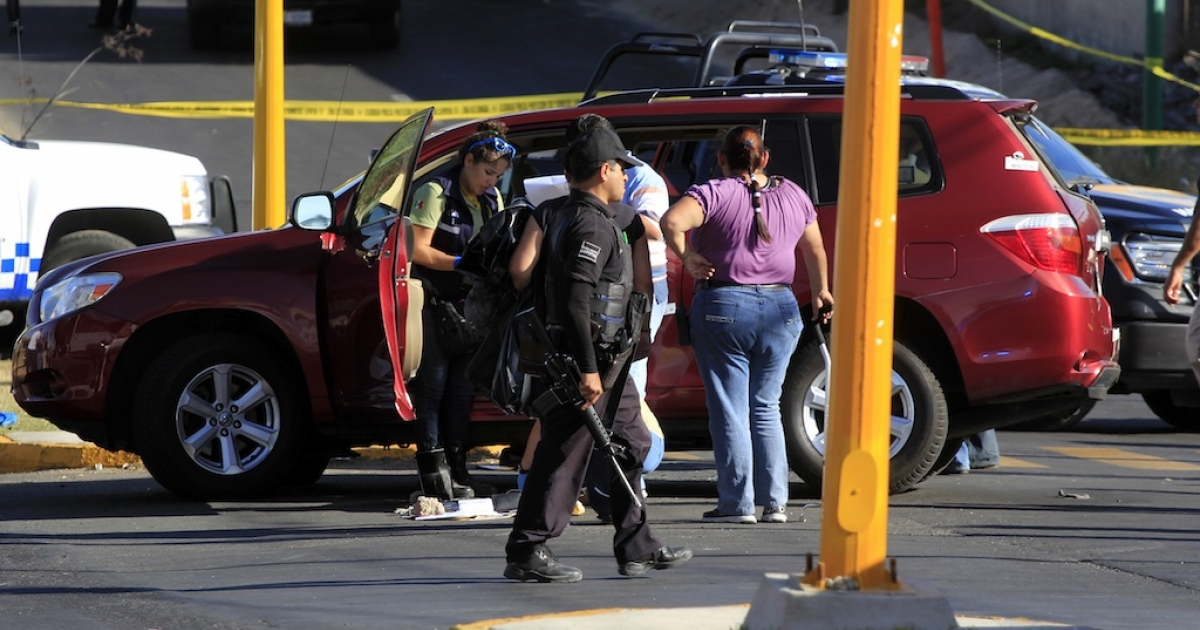 Police and forensic officers at the spot where Jose de Jesus Gallegos Alvarez, the recently appointed tourism minister of Jalisco state, was shot dead on Saturday.</p>