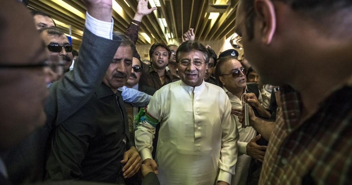 Former Pakistani president Pervez Musharraf is greeted by supporters after landing on Pakistani soil at Karachi airport on March 24, 2013 in Karachi, Pakistan.</p>