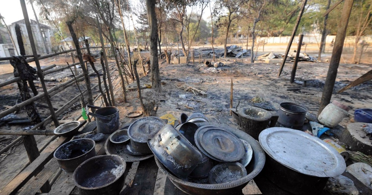 Burnt kitchenware sits on a shelf at house which was burnt in communal violence in Yamethin, near the capital Naypyidaw, after unrest spread in central Myanmar on March 24, 2013.</p>