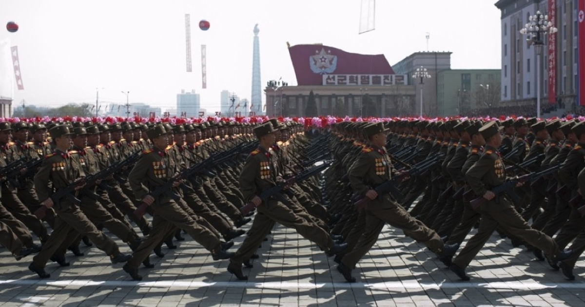 North Korean soldiers march during a military parade to mark 100 years since the birth of North Korea's founder Kim Il-Sung in Pyongyang on April 15, 2012.</p>