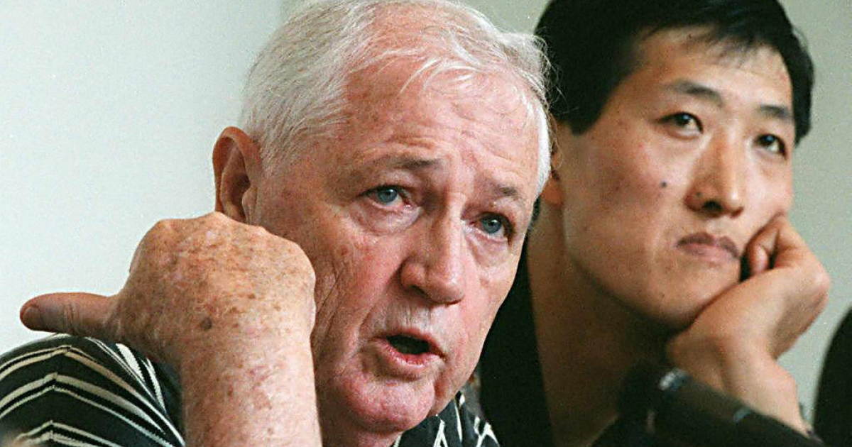 Jack Donohue, former Canadian basketball team coach, and North Korean basketball player Ri Myong-hun speak to reporters on June 10, 1997, during a news conference in Ottawa, Canada. Ri, who is 7-feet-8, was trying to make the NBA.</p>