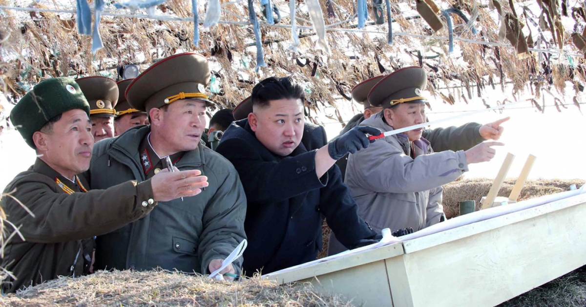 This undated picture taken by North Korea's official Korean Central News Agency on March 11, 2013 shows North Korean leader Kim Jong Un (C) inspecting the Wolnae Islet Defense Detachment in North Korea's western sector near the disputed maritime frontier with South Korea.</p>