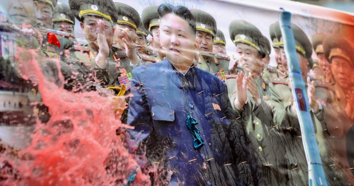A South Korean conservative activist throws a water balloon onto a banner showing North Korean leader Kim Jong-Un (C) and his troops during a rally denouncing North Korea's threat in Seoul on March 12, 2013. North Korea leader Kim Jong-Un threatened to 'wipe out' a South Korean island as Pyongyang came under new economic and diplomatic fire on March 12, from US sanctions and UN charges of gross rights abuses.</p>