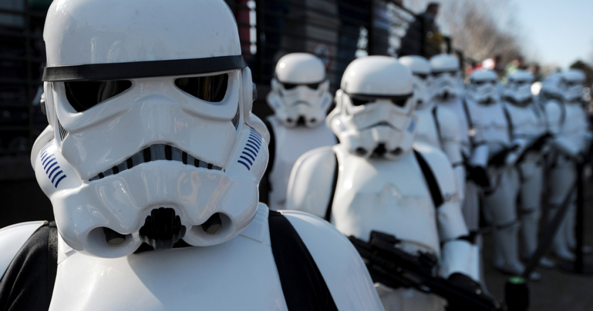 Star Wars Stormtroopers pose for photographers in a queue at Legoland in Windsor west of London on March 24, 2012, to mark the launch of the new Star Wars Miniland Experience.</p>