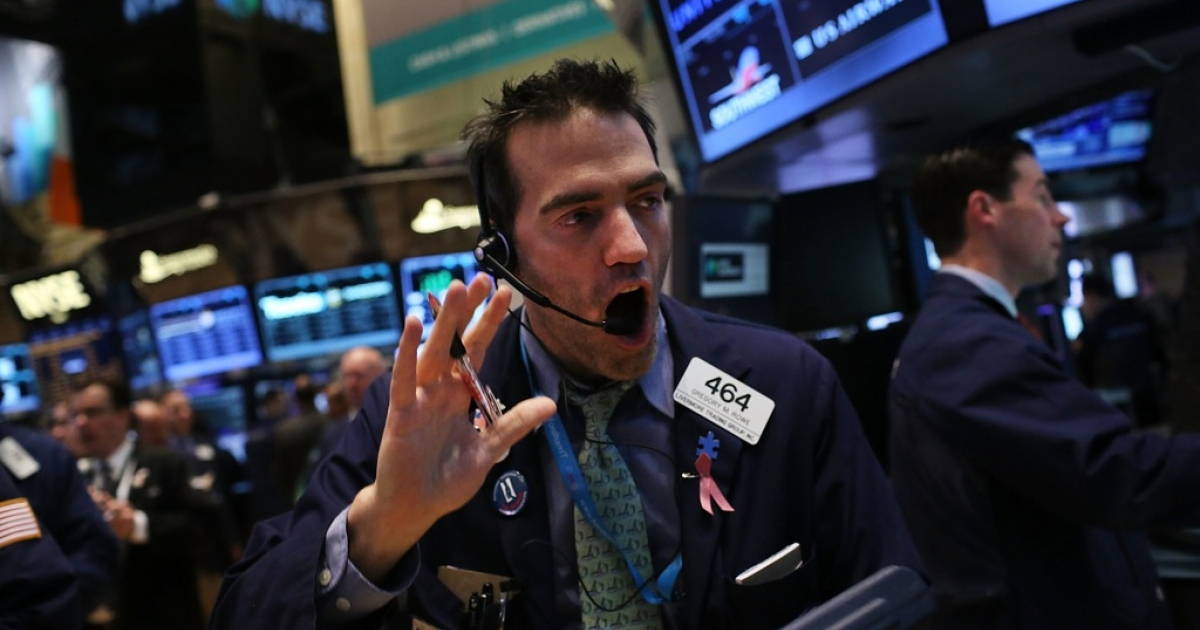 Traders work on the floor of the New York Stock Exchange on March 6, 2013 in New York City. One day after the Dow Jones Industrial Average rallied to a record high to close at 14,253.77, stocks were up over 40 points in morning trading.</p>
