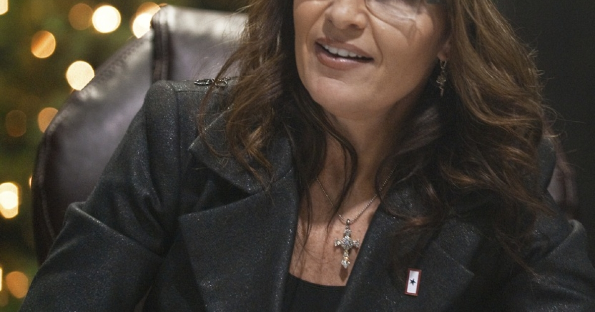 Former Alaska Governor and Republican vice presidential candidate Sarah Palin arrives to sign copies of her recently released book 'Going Rogue: An American Life', sitting in front of a Christmas Tree on December 5, 2009. She is penning her third book about
