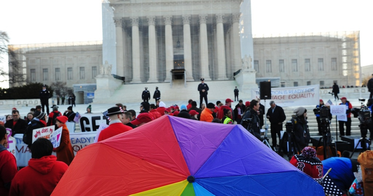 Supporters of same-sex marriage gather in front of the US Supreme Court on March 26, 2013 in Washington, DC.</p>