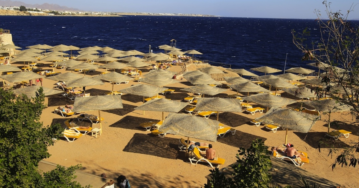 This picture taken on January 3, 2012, shows tourists enjoying the beach at the Red Sea resort city of Sharm el-Sheikh in Egypt.</p>