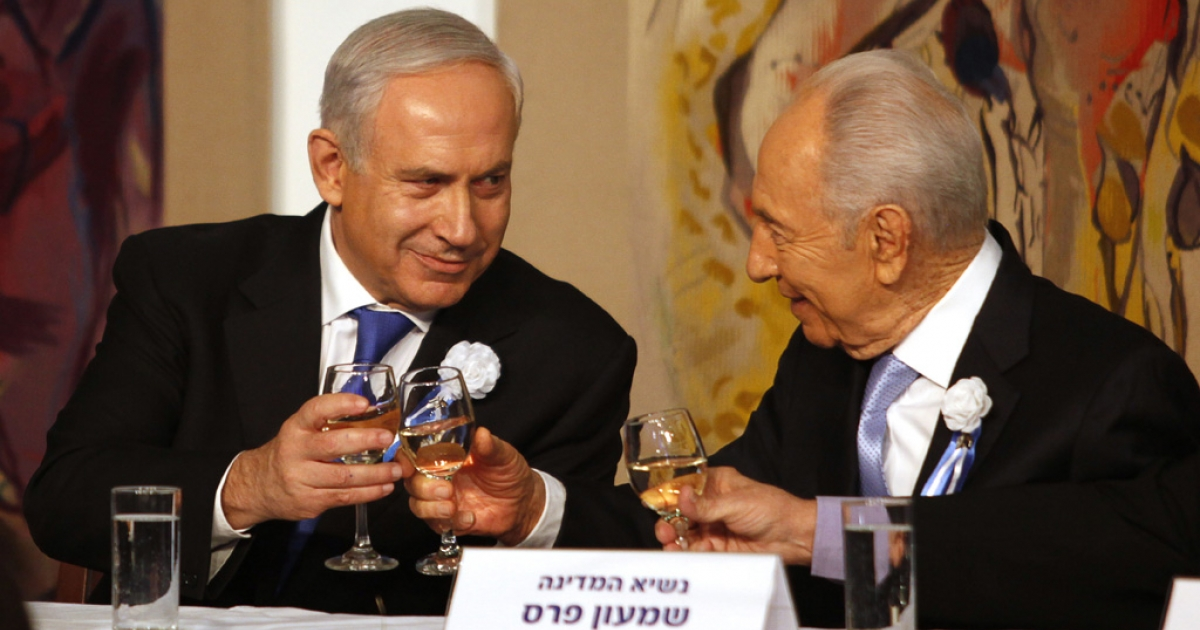 Israeli Prime Minister Benjamin Netanyahu, left, speaks with President Shimon Peres during a reception marking the opening of the 19th Knesset (Israeli parliament) on February 5, 2013 in Jerusalem.</p>