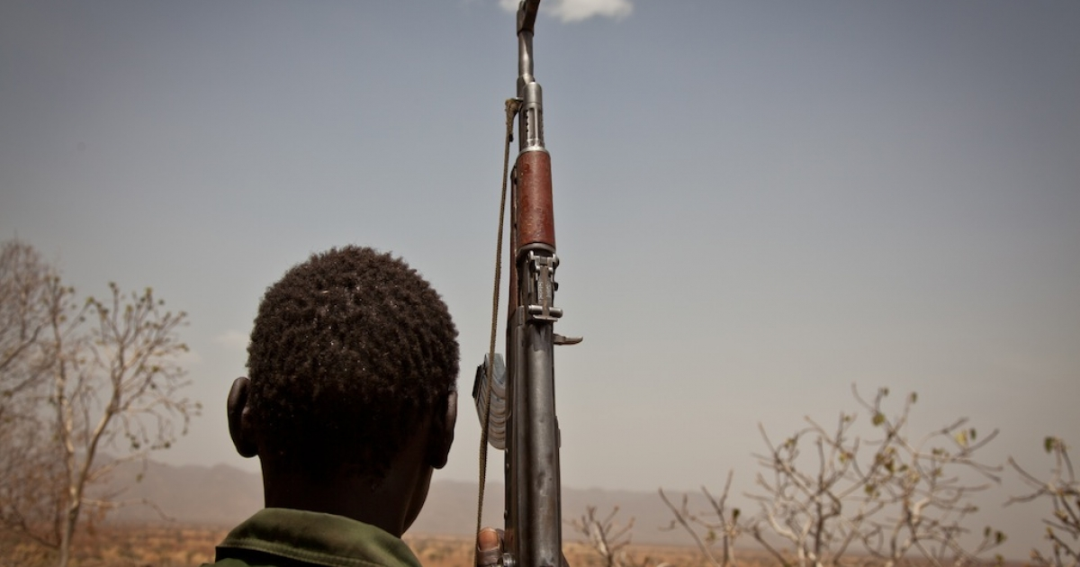 A Sudan People's Liberation Movement rebel soldier looks out toward Talodi in of Sudan, on April 25, 2012.</p>