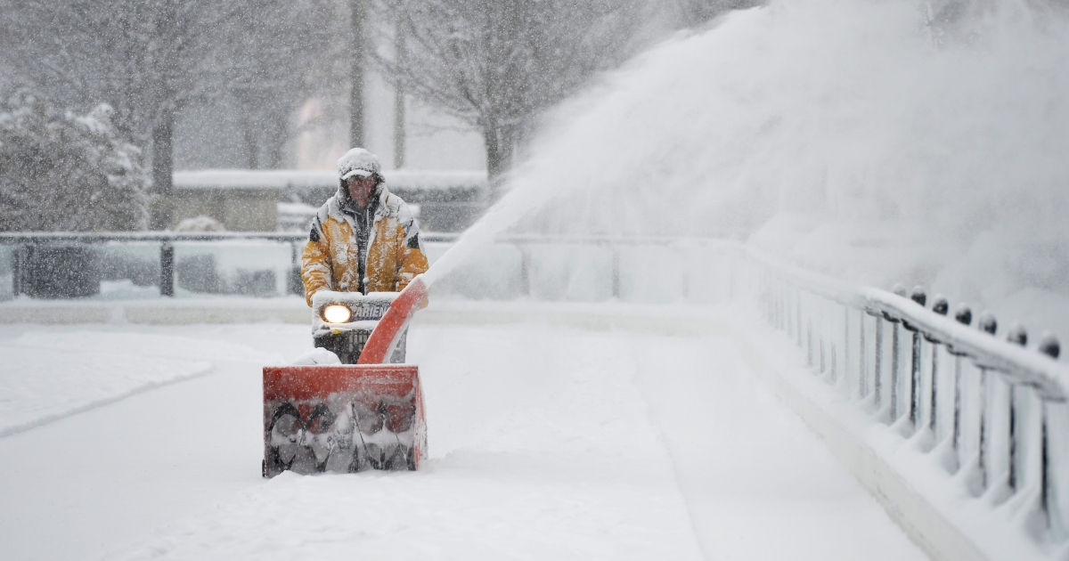 Mike Davis clears snow from the Millennium Park skating rink on March 5, 2013 in Chicago, Illinois. The worst winter storm of the season is expected to dump 7-10 inches of snow on the Chicago area with the worst expected for the evening.</p>