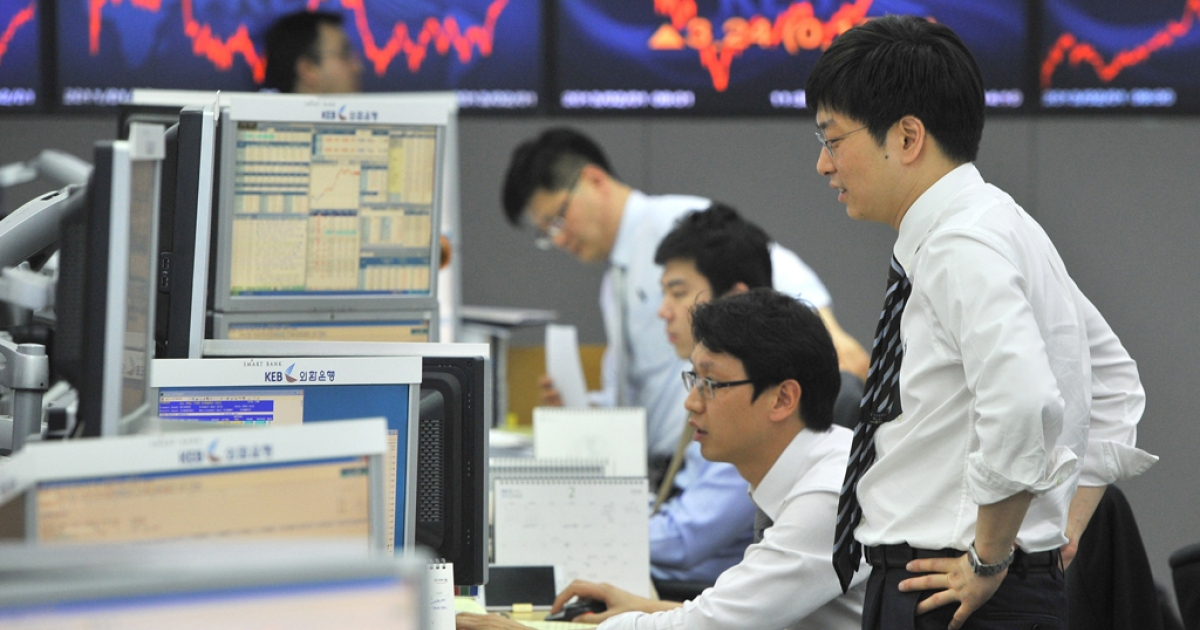 This photo taken on Feb. 1, 2013, shows currency traders monitoring exchange rates in a dealing room at the Korea Exchange Bank in Seoul, South Korea. A surging won and waning yen are eroding the bottom lines of South Korea's export powerhouses.</p>