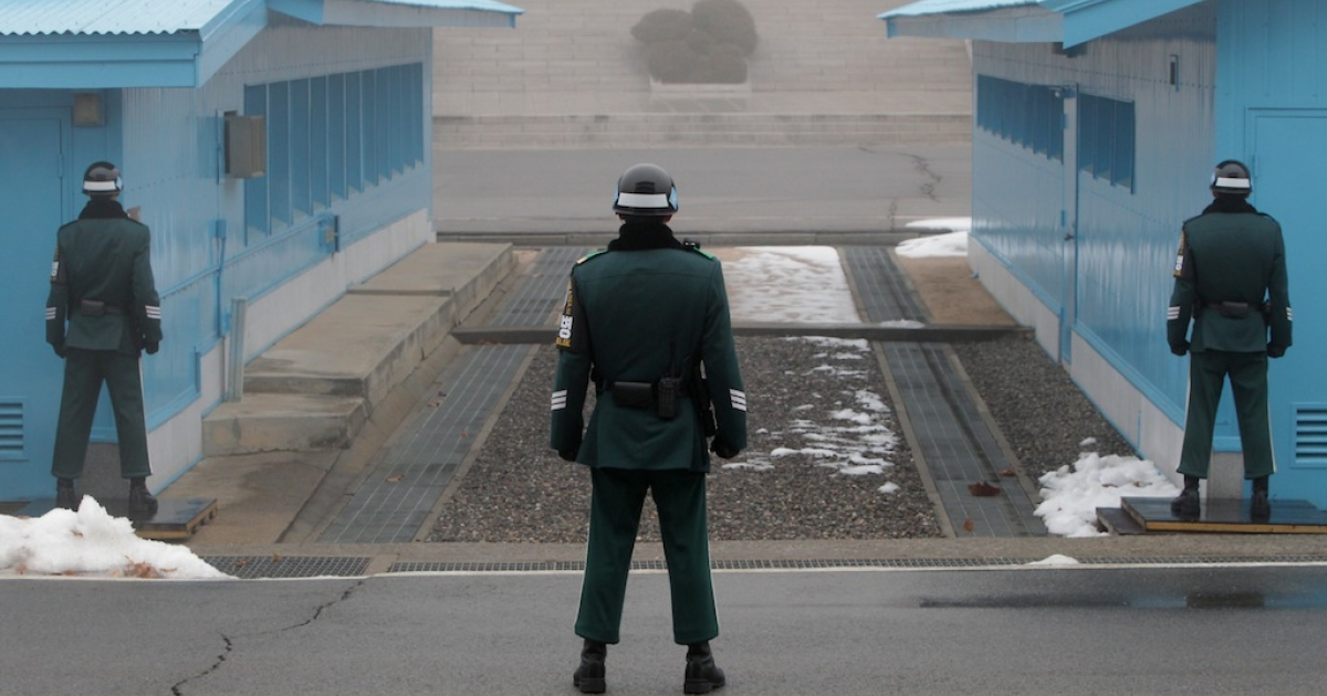 South Korean soldiers stand guard at the border village of Panmunjom between South and North Korea at the Demilitarized Zone (DMZ) on Feb. 27, 2013 in South Korea.</p>