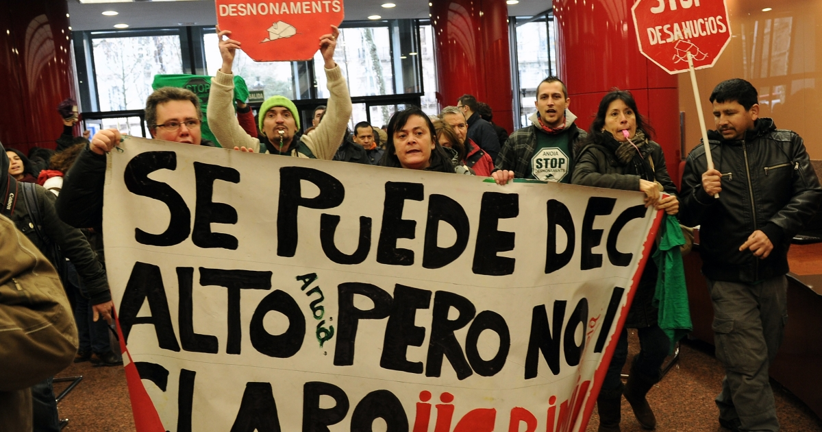 Anti-eviction activists protest inside a bank: