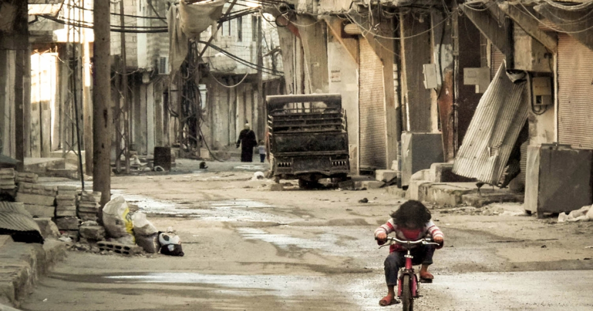 A Syrian girl rides her bicycle in an almost deserted street in the Teshrin neighborhood of Damascus on Jan. 3, 2013. According to Israeli military intelligence, the Syrian government has repeatedly used chemical weapons against the rebels fighting to overthrow it.</p>
