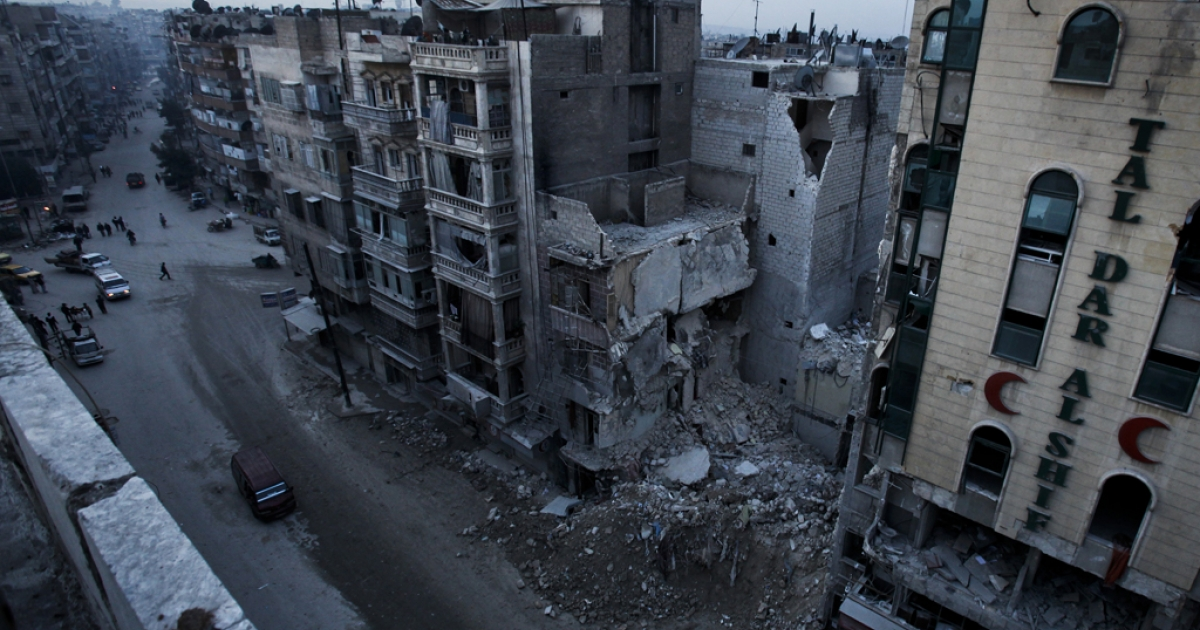 A December 2, 2012 file picture shows the Dar Al-Shifa hospital in the northern city of Aleppo after part of it was bombed by a regime aircraft in November.  Syria's conflict is mired in stalemate, with President Bashar al-Assad's forces defending Damascus and territory in the west and centre while rebels control the north and east, with neither able to make major advances.</p>
