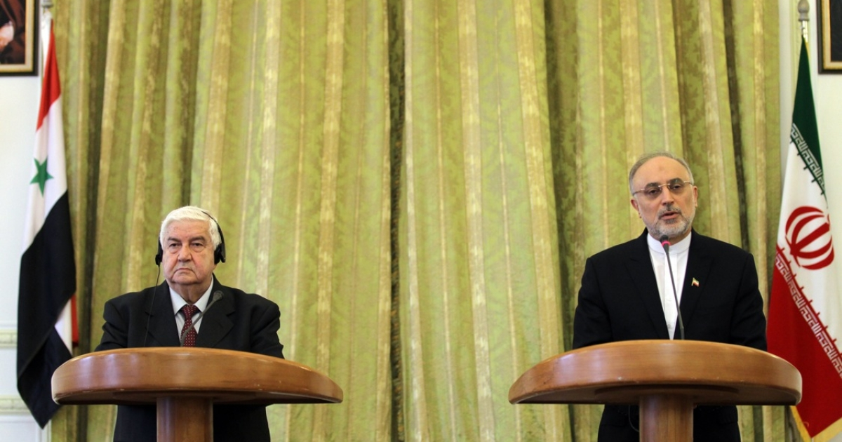 Iranian Foreign Minister Ali Akbar Salehi (R) and his Syrian counterpart Walid Muallem during a press conference on March 2, 2013 in the Iranian capital Tehran. Syria and Iran have accused the US of hypocrisy for offering aid to Syrian rebels.</p>