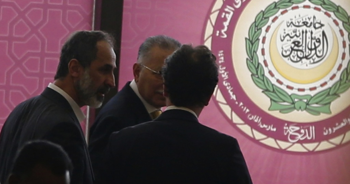 Ahmed Moaz al-Khatib (L), head of the Syrian opposition delegation, attends the opening of the Arab League summit in the Qatari capital, Doha, on March 26, 2013.</p>