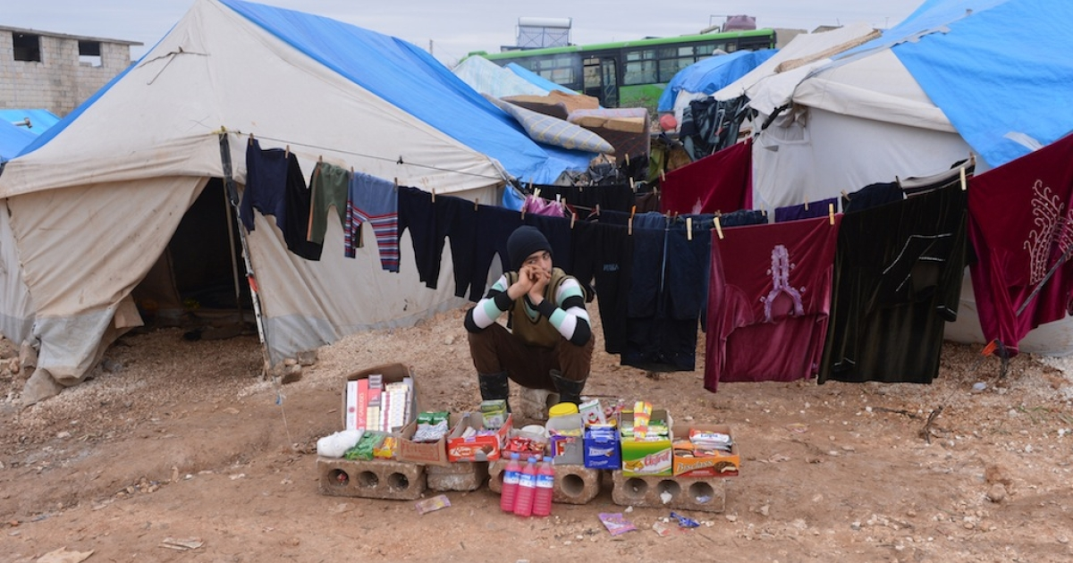 A new quick-and-easy concretable tent developed by a British firm may be able to provide  refugees more secure shelter. Here, a displaced Syrian youth sells goods in front of his tent at the refugee camp of Qah along the Turkish border in the village of Atme on Feb. 7, 2013.</p>