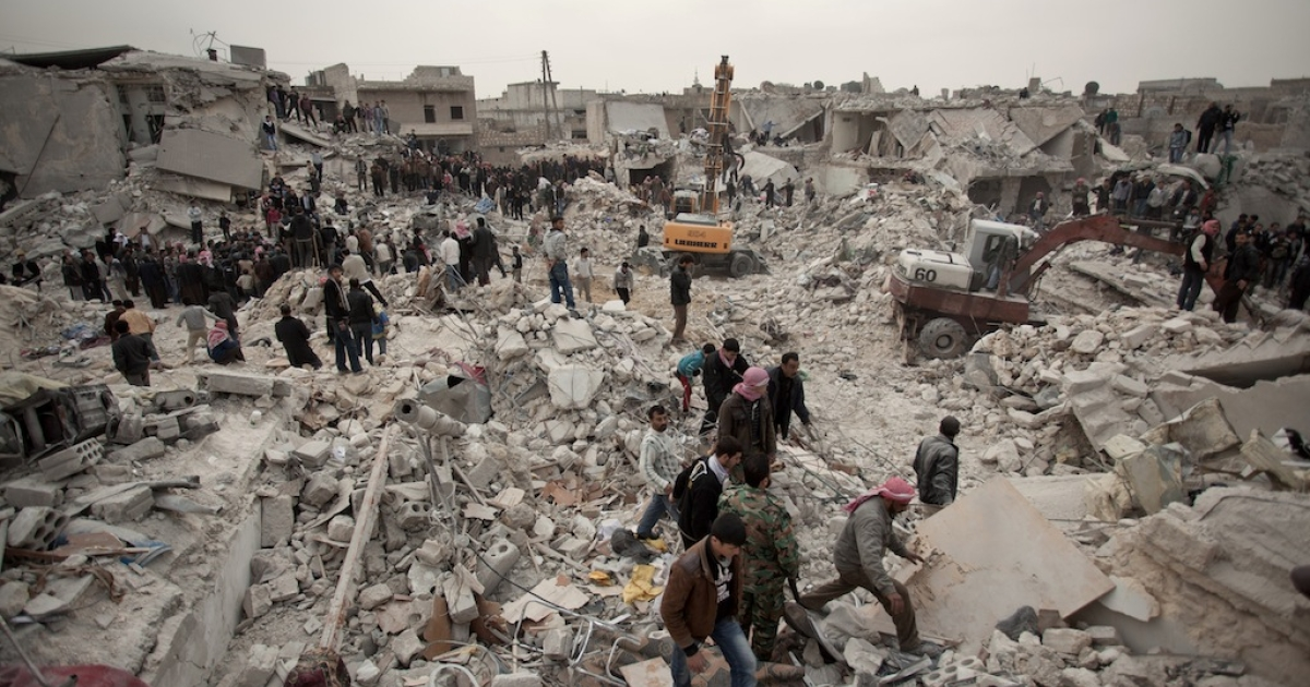 Syrians search for survivors and bodies amid the rubble of buildings in the Tariq al-Bab district of the northern city of Aleppo on Feb. 23, 2013.</p>