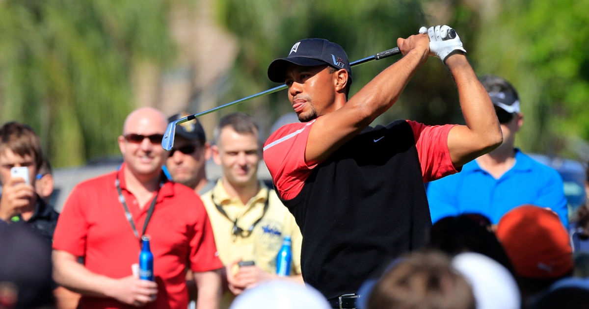 Tiger Woods plays a shot on the 8th hole during the final round of the Arnold Palmer Invitational presented by MasterCard at the Bay Hill Club and Lodge on March 25, 2013 in Orlando, Fla.</p>