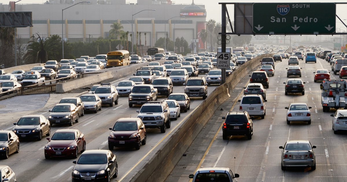 Traffic on the northbound and southbound lanes of the 110 Harbor Freeway starts to stack up during rush hour on Feb. 5, 2013, in Los Angeles, Calif. Founded in 2005, INRIX is a company that collects data to gauge the correlation between the status of the economy and traffic patterns.</p>