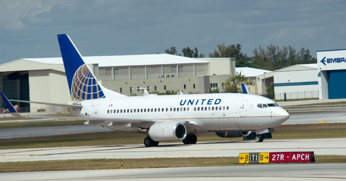 A United Airlines jet takes off from Fort Lauderdale-Hollywood International Airport on Feb. 21, 2013, in Ft. Lauderdale, Fla. Flat-bed seats in business class and electrical outlets at every seat are among the amenities of United's refreshed Boeing 757 p.s. (premium service) aircraft, which took to the skies on Monday.</p>