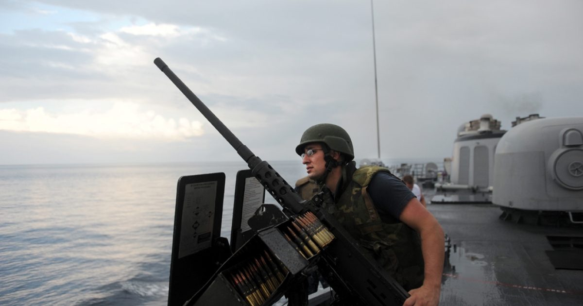 Crew members of the USS Thach observe suspect Ecuadorean fishing boats on March 3, 2013, during a drug interdiction while patrolling international waters in the Pacific Ocean near Colombia and Ecuador. The USS Thach participates in the Martillo Operation, a US led multilateral operation launched in January 2012 to combat drug smuggling in Central America.</p>
