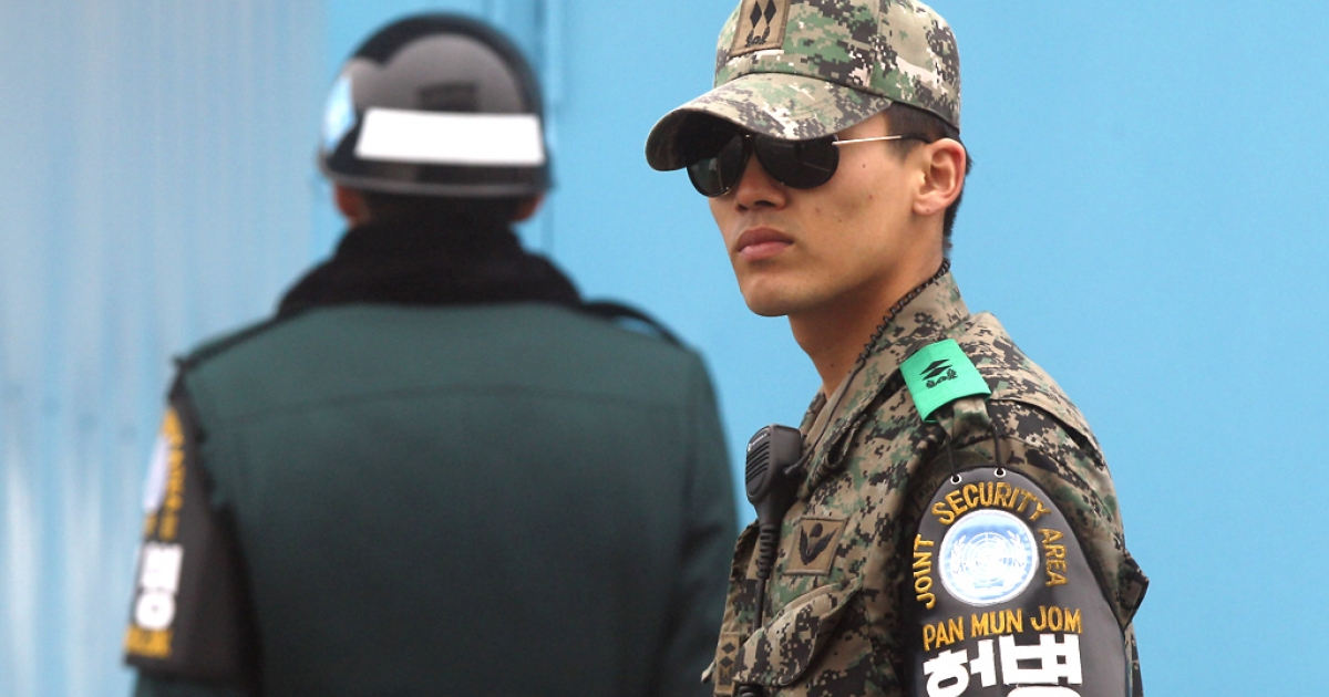 South Korean soldiers stand guard at the border village of Panmunjom between South and North Korea at the Demilitarized Zone (DMZ) on February 27, 2013 in South Korea.</p>