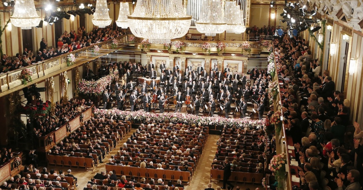 People applaud after the traditional New Years Concert with the Vienna Philharmonic Orchestra on January 1, 2013 at the music association in Vienna, Austria.</p>