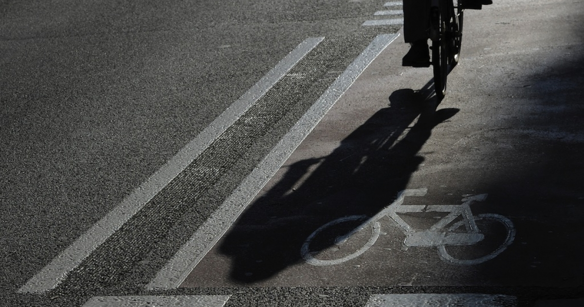 A picture taken on Feb. 20, 2013 shows the shadow of a man riding on a bike lane in the center of Barcelona.</p>