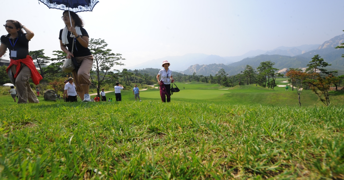 Chinese tourists visiting a golf course which has been closed for over three years at the Mount Kumgang international tourist zone in North Korea on September 1, 2011.</p>