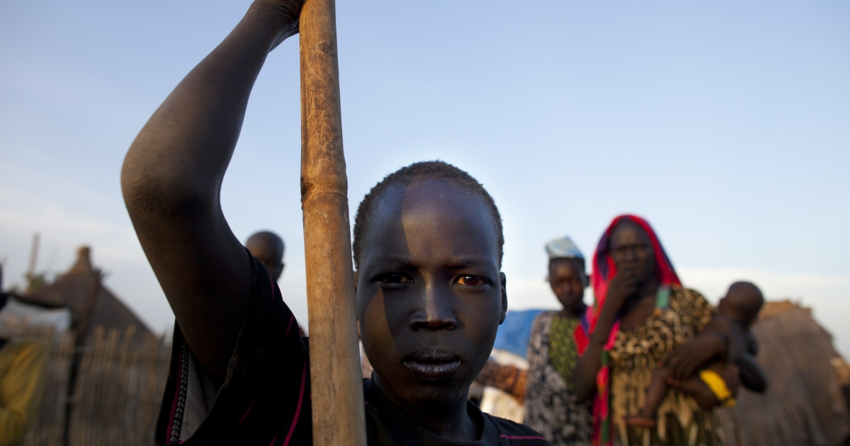A man from the Dinka tribe stands at a settlement outside the city center July 19, 2012 in Juba, South Sudan.</p>