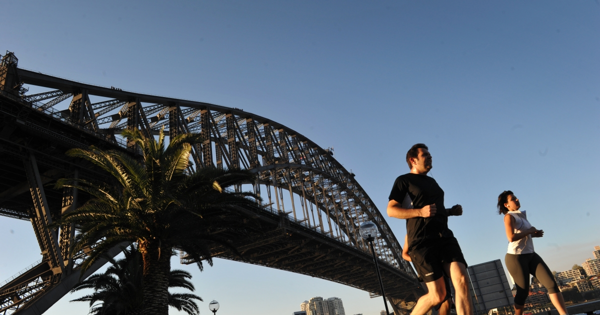 People jog along the Sydney Harbour with the Sydney Harbour bridge seen in the background on September 10, 2012. Australia was recently ranked as the happiest country in the world according to 11 measures. The OECD's Better Life Index seeks to go beyond GDP to measure well-being among countries.</p>