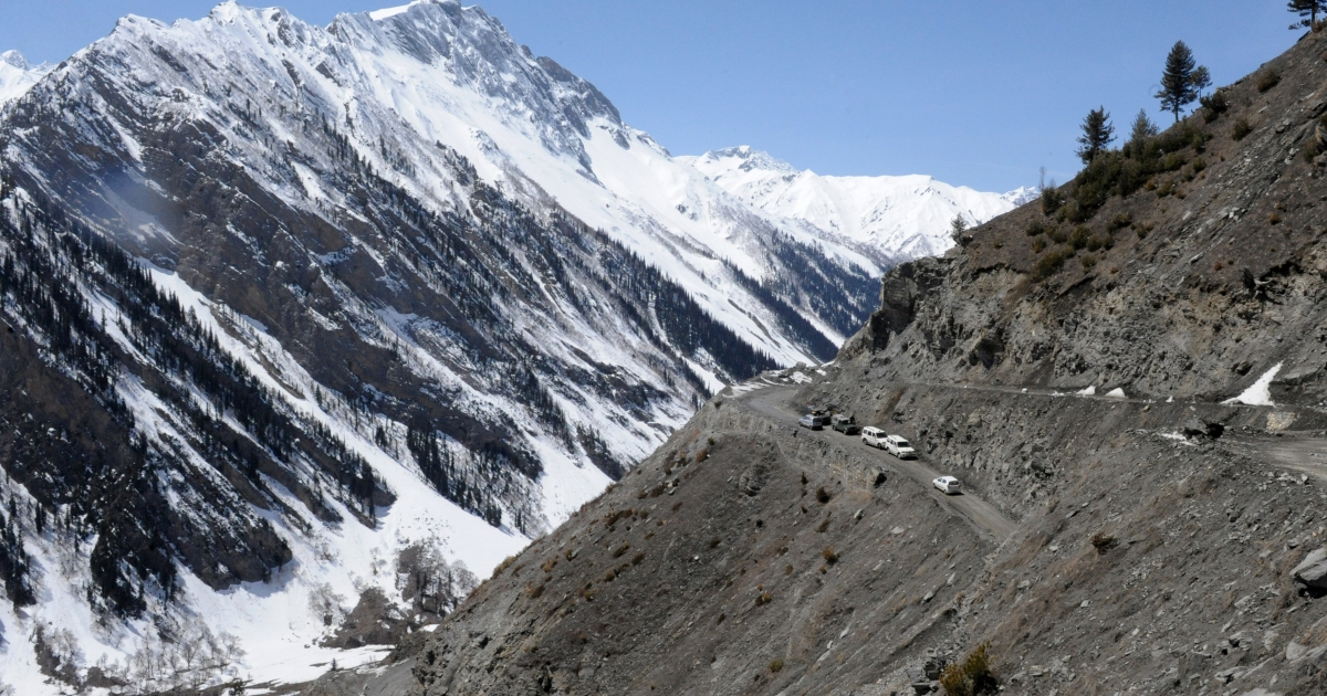 An Indian convoy negotiates the Srinagar-Leh highway in Zojila Pass, which connects Kashmir, India, with the Ladakh region.</p>