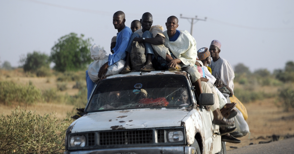 Fleeing residents head home on April 30, 2013 after Islamist clash with soldiers on April 25, 2013 in the remote northeast town of Baga, Borno State.</p>