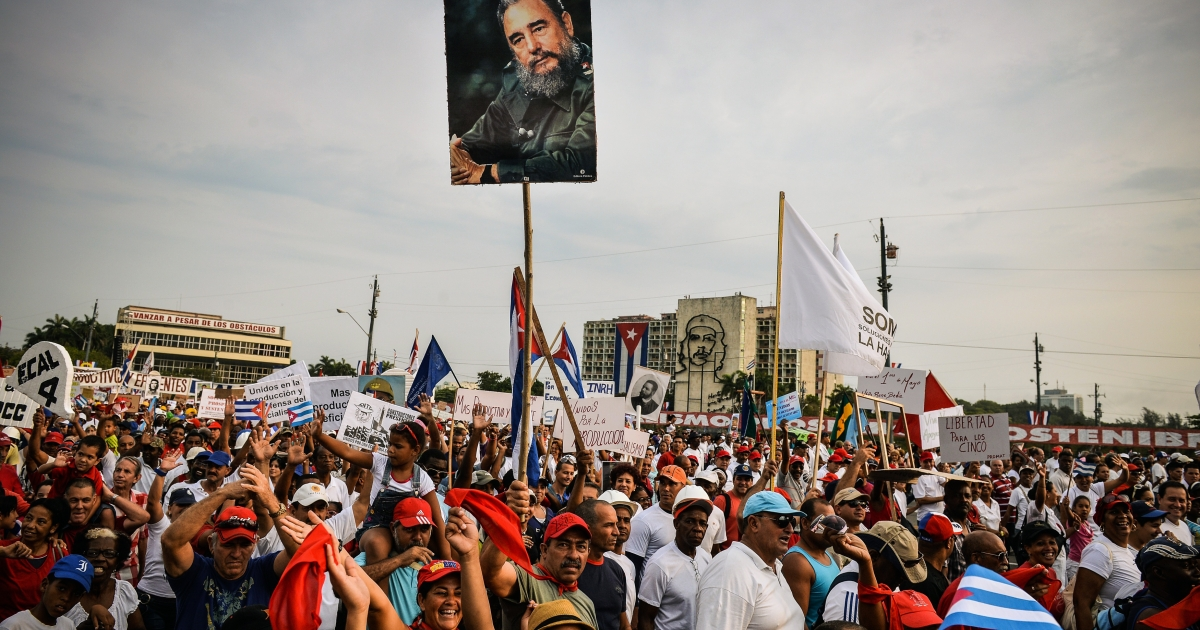 Cuban workers show a portrait of former President Fidel Castro during May Day celebrations at Revolution Square in Havana on May 1, 2013. The State Department said Wednesday that Cuba would remain on a list of states that sponsor terrorism.</p>