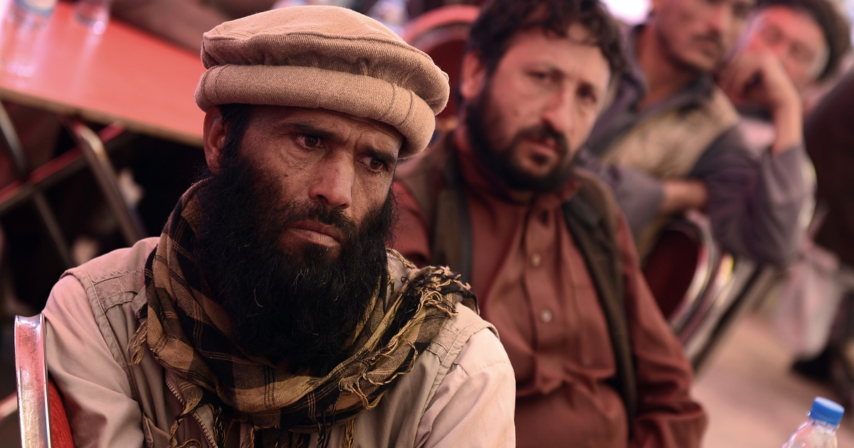 Afghan villagers listen to an address during a gathering against Pakistan following recent cross-border clashes, in the Kouchkin area on the outskirts of Kabul on May 6, 2013.</p>