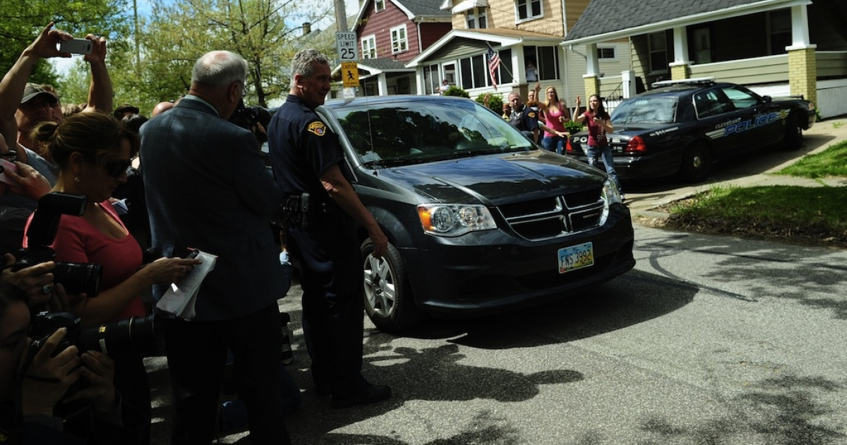 A car carrying Amanda Berry arrives at her sister's house, on May 8, 2013 in Cleveland, Ohio. Three brothers have been arrested in connection with the kidnapping of three women, including Amanda Berry. They were found safe in a home after being missing for a decade, authorities said. There were more questions than answers the day after the stunning turn of events that began with a frantic arm sticking out of a screen door, a woman screaming for help, and a neighbor kicking in the door to free her in a working-class neighborhood of the city in the American heartland. Ariel Castro and his brothers - Pedro, 54, and Onil, 50 have been detained, authorities said.</p>