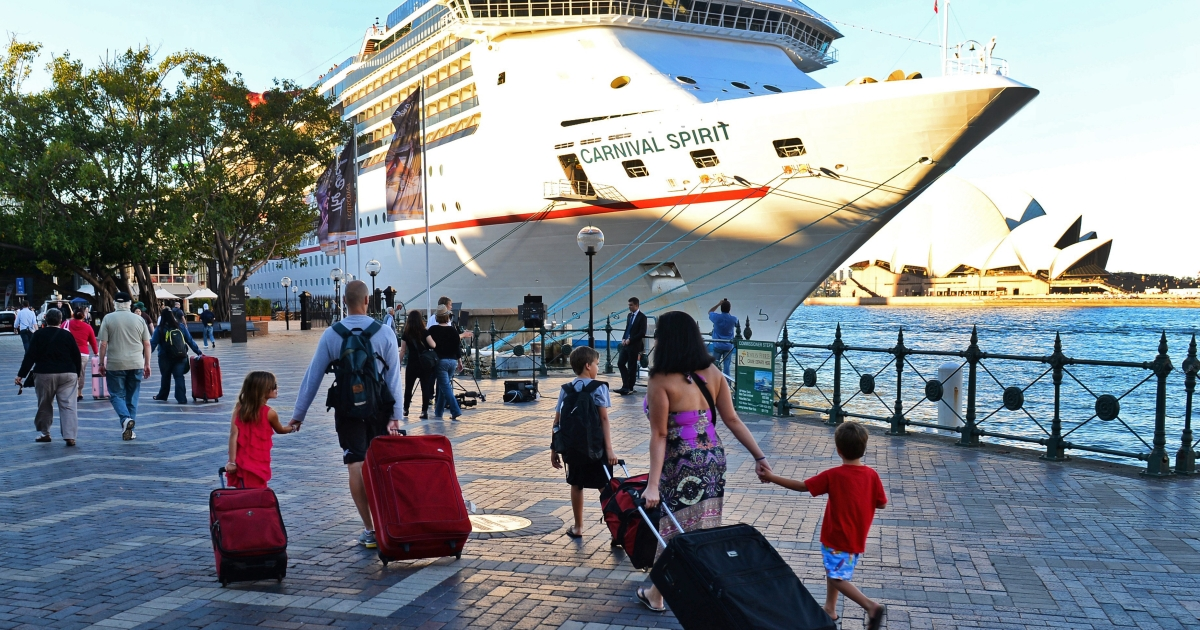 Passengers arrive at Sydney's Circular Quay to board the cruise ship Carnival Spirit for a Pacific cruise, on May 9, 2013.</p>