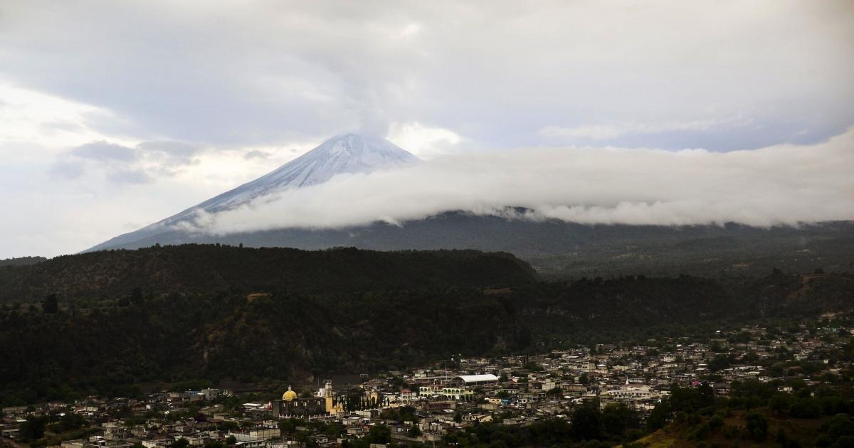The Santiago Xalitxintla community lies beneath the Popocatepetl Volcano in Puebla, Mexico, on May 13, 2013.</p>