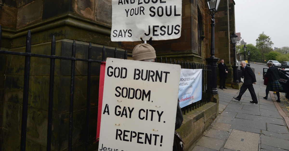 A protestor stands outside the entrance to the Church of Scotland General Assembly on May 20,2013 in Edinburgh, Scotland. Members will be discussing whether to allow people in same sex relationships to be ordained as Ministers in the Church of Scotland.</p>