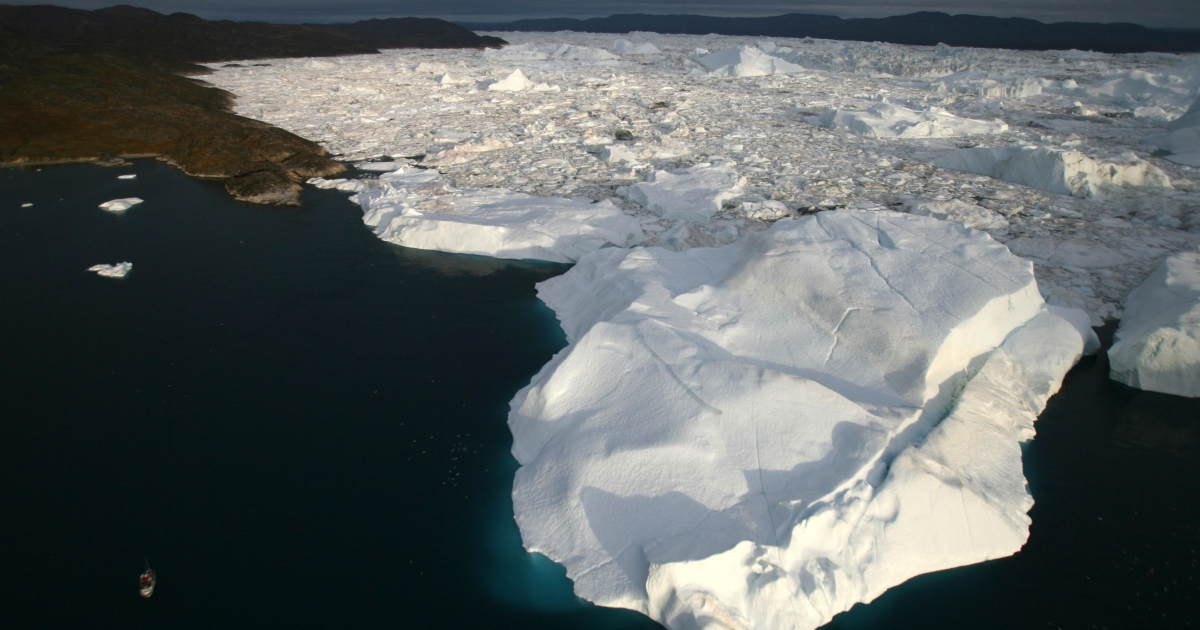 An aerial view of icebergs as they float out of the Jacobshavn Fjord into the Jacobshavn bay, August 29, 2007 near Ilulissat, Greenland.</p>