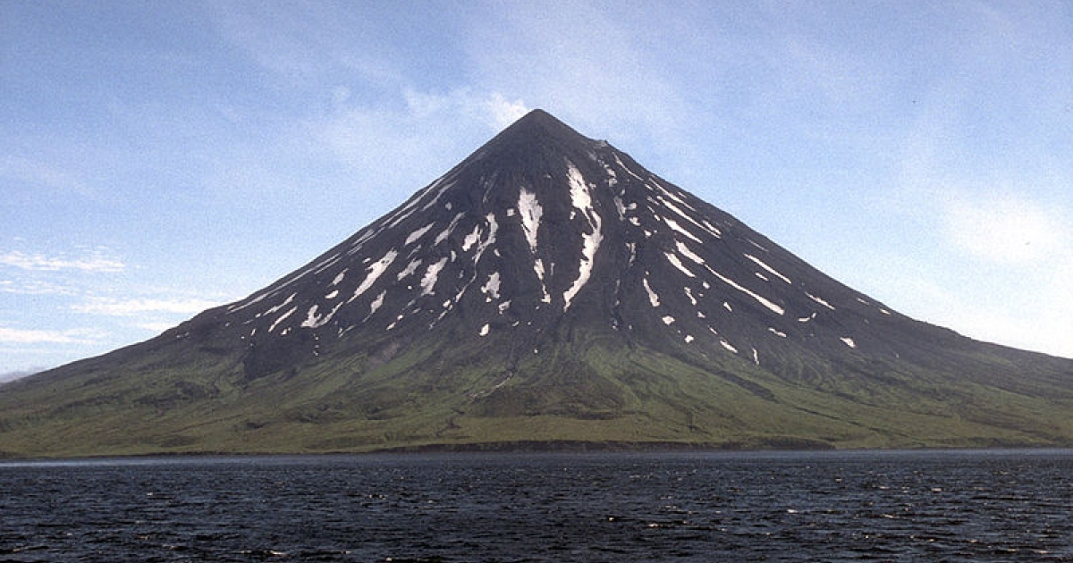 Mount Cleveland forms the western half of Chuginadak Island in the central Aleutian Islands. This symmetrical, 1,730-m (5,676 ft)-high stratovolcano and has been the site of numerous eruptions in the last two centuries; the most recent eruption occurred in 1994. In 1944, a U.S. Army serviceman was reportedly killed by an eruption from Mount Cleveland.</p>